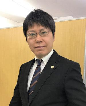 千住弁護士の顔写真
