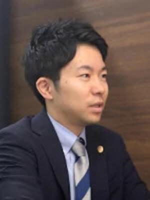 遠藤弁護士の顔写真